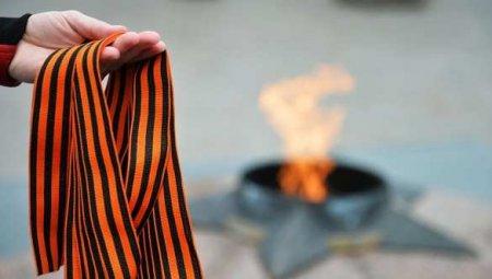 ВРиге полиция издевается надтеми, ктохочет почтить память павших вВОВ(ФОТО)